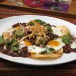 Huevos rancheros (Eggs with fried tortilla and salsa)
