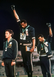 The Athletes Tommie Smith and John Carlos make the Black Power signal during the 1968 Olympic Games in Mexico City as a sign of protest.
