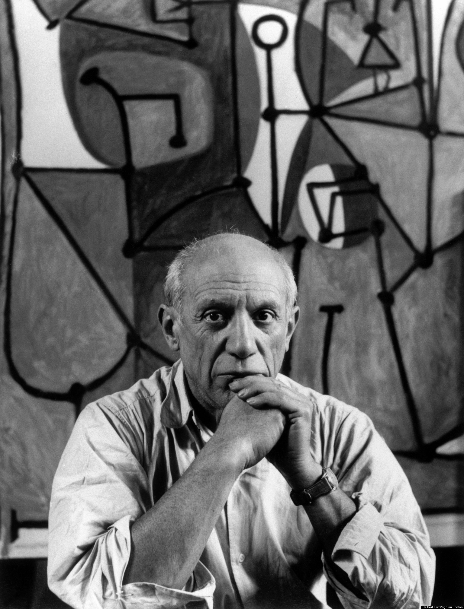 """FRANCE. Paris. Rue des Grands Augustins. Pablo PICASSO at his studio in front of """"La Cuisine"""". 1948. P-FR-PIC-003[lF][lF]Contact email: New York : photography@magnumphotos.com Paris : magnum@magnumphotos.fr London : magnum@magnumphotos.co.uk Tokyo : tokyo@magnumphotos.co.jp Contact phones: New York : +1 212 929 6000 Paris: + 33 1 53 42 50 00 London: + 44 20 7490 1771 Tokyo: + 81 3 3219 0771 Image URL: https://www.magnumphotos.com/Archive/C.aspx?VP3=ViewBox_VPage&IID=2S5RYD21HSI&CT=Image&IT=ZoomImage01_VForm"""