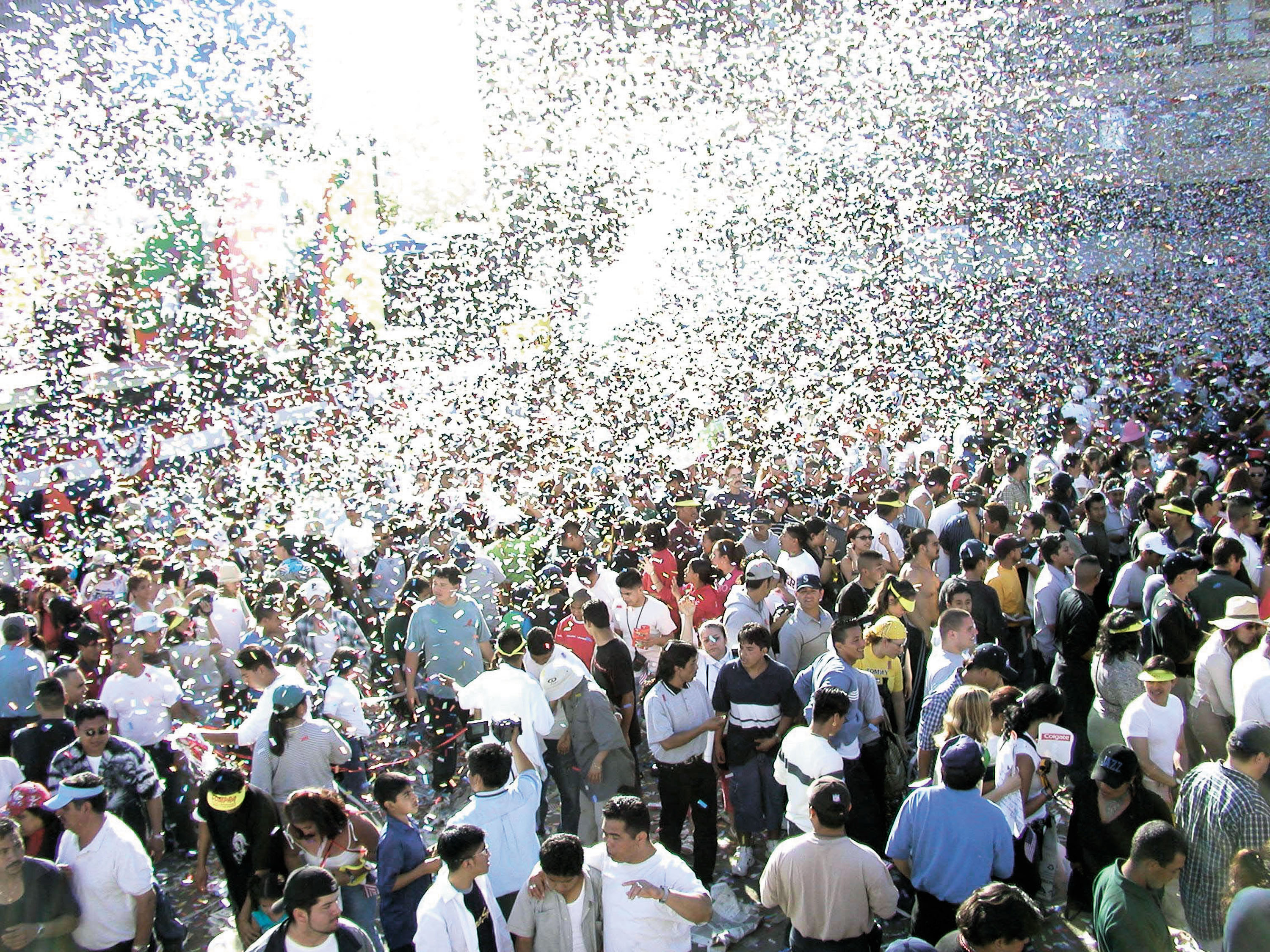 404619 07: Confetti is released on the crowd at the end of a concert during the 13th Annual McDonald's Fiesta Broadway, an early Cinco De Mayo celebration April 28, 2002 in downtown Los Angeles, CA. (Photo by Alexander Sibaja/Getty Images)
