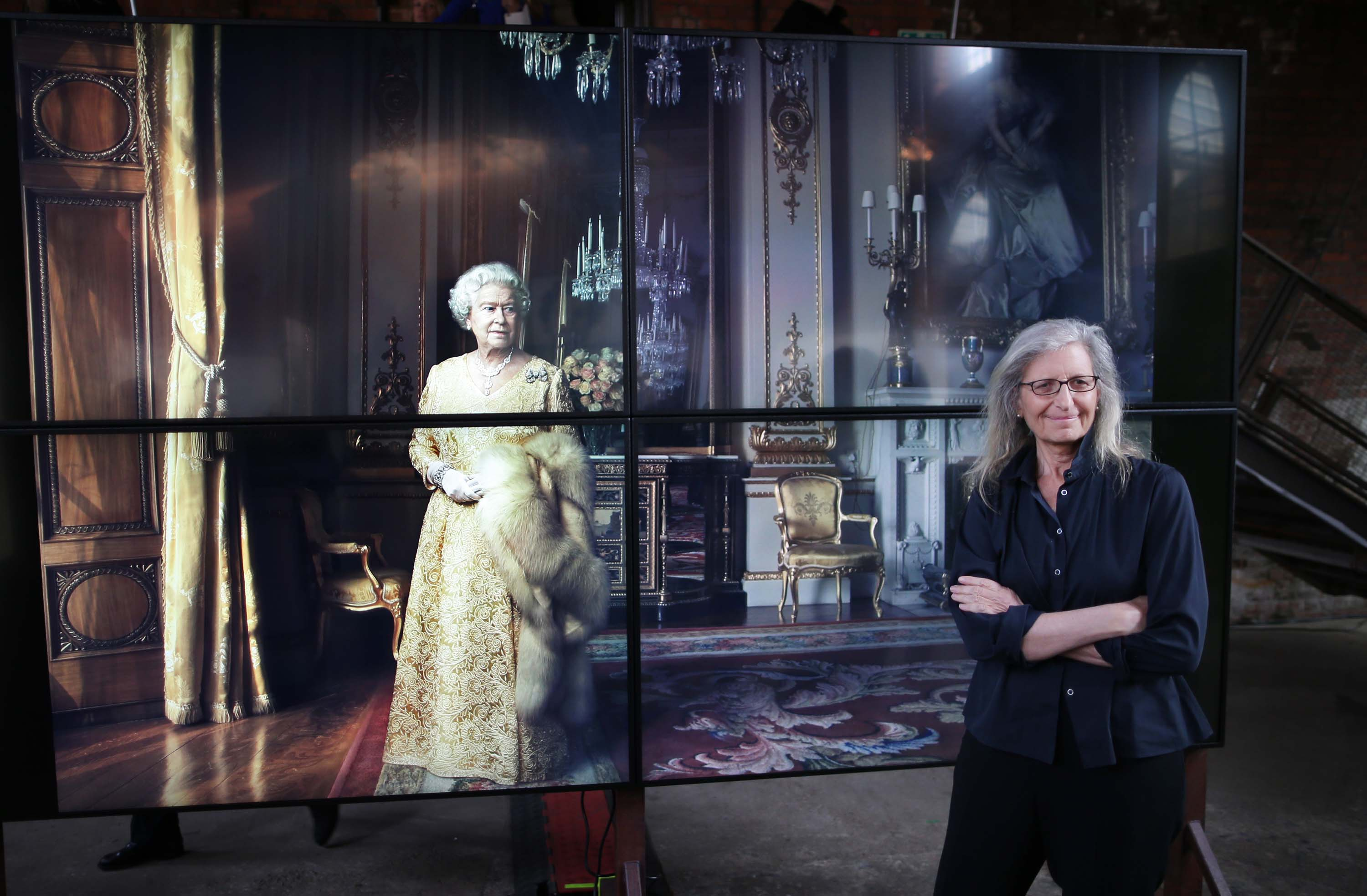 © Licensed to London News Pictures. This image is free to use ONLY in connection with the launch of the 'WOMEN: New Portraits' exhibition. 13/1/2016. London, UK. UBS and Annie Leibovitz launch 'WOMEN:New Portraits' at Wapping Hydraulic Power Station. Here Annie stands with an earlier portrait of Queen Elizabeth II. The exhibition opens to the public from Saturday 16th January until 7th February 2016. The newly commissioned photographs by the world renowned photographer will travel to 10 cities over the course of twelve months ñ London, Tokyo, San Francisco, Singapore, Hong Kong, Mexico City, Istanbul, Frankfurt, New York and Zurich. Access will be free to the public. Photo credit: Peter Macdiarmid.